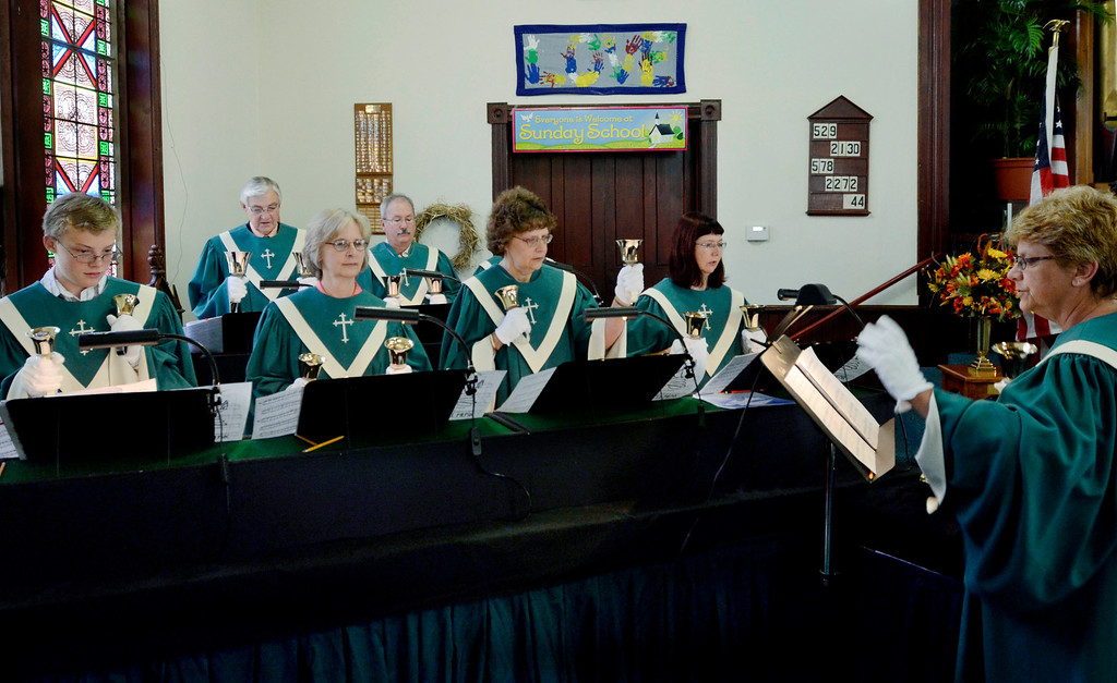 . Mike McMahon - The Record, The Melrose United Methodist Church Handbell Choir directed by Janet Herrington performs at the Church\'s 160th Anniversary, September 29, 2013.