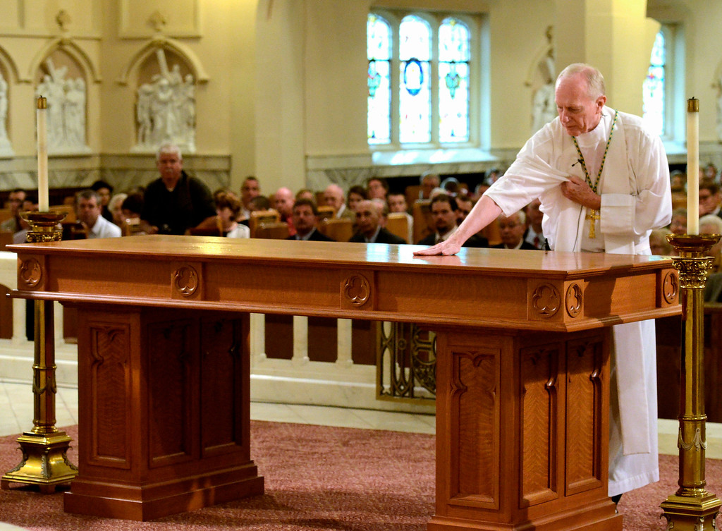 . Mike McMahon - The Record, Rev. Howard J. Hubbard, D.D., Bishop of Albany anoints the new Altar with sacramental oils. St. Mary of the Assumption Parish celebrated 100 years with a mass at the Waterford Church, Sunday 10/06/2013.