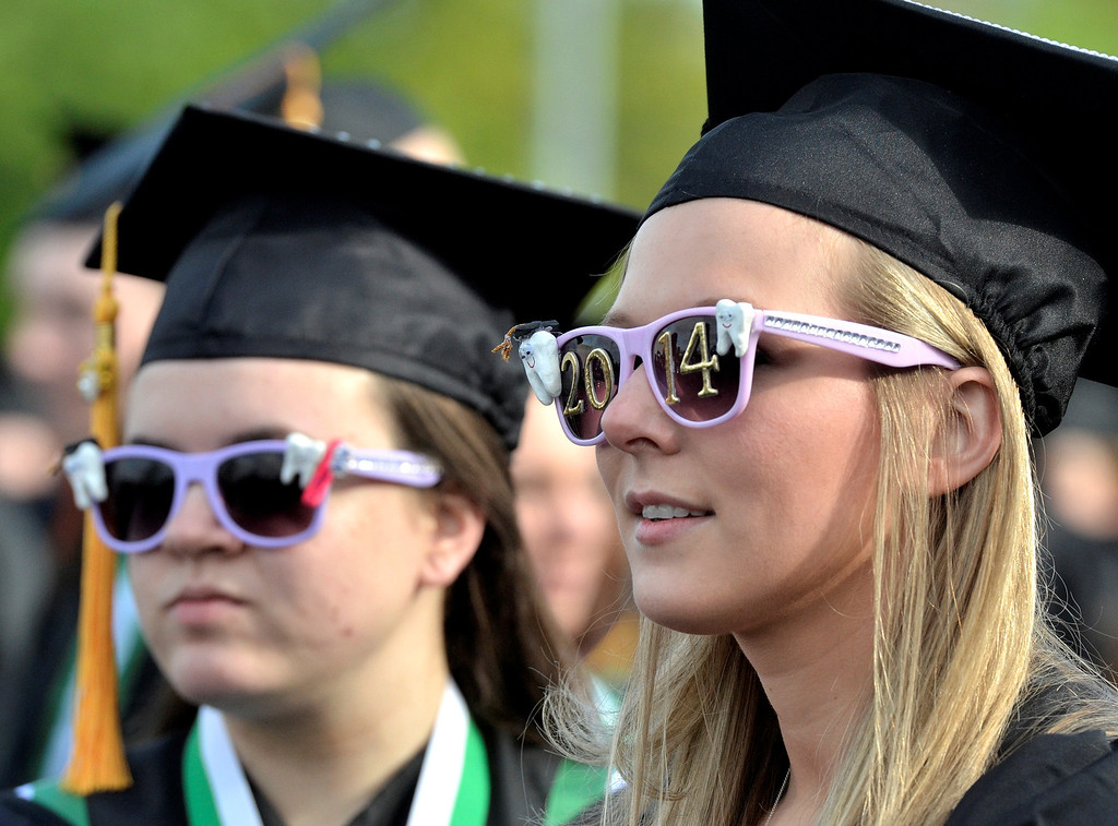 . Dental Hygiene graguates Heidi Beth Pikcilingus of Schenectady and Beth Roberts of Albany at Hudson Valley Community College commencement at the Joseph L. Bruno baseball field in Troy, Saturday  May 17,  2014 (Mike McMahon - The Record)